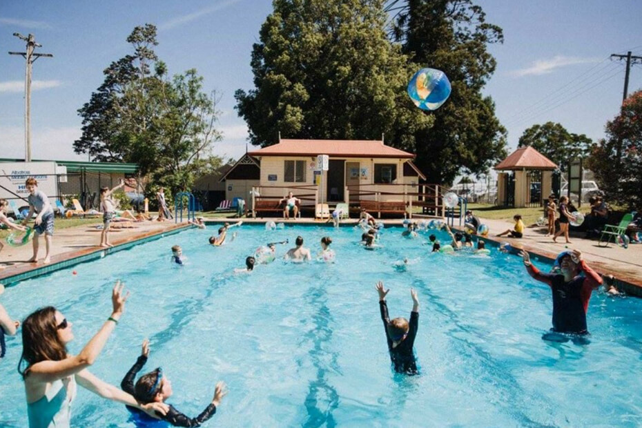 Photo of Berry Village pool with patrons in pool
