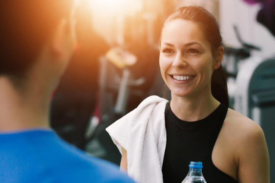 Woman smiling and talking to her personal trainer