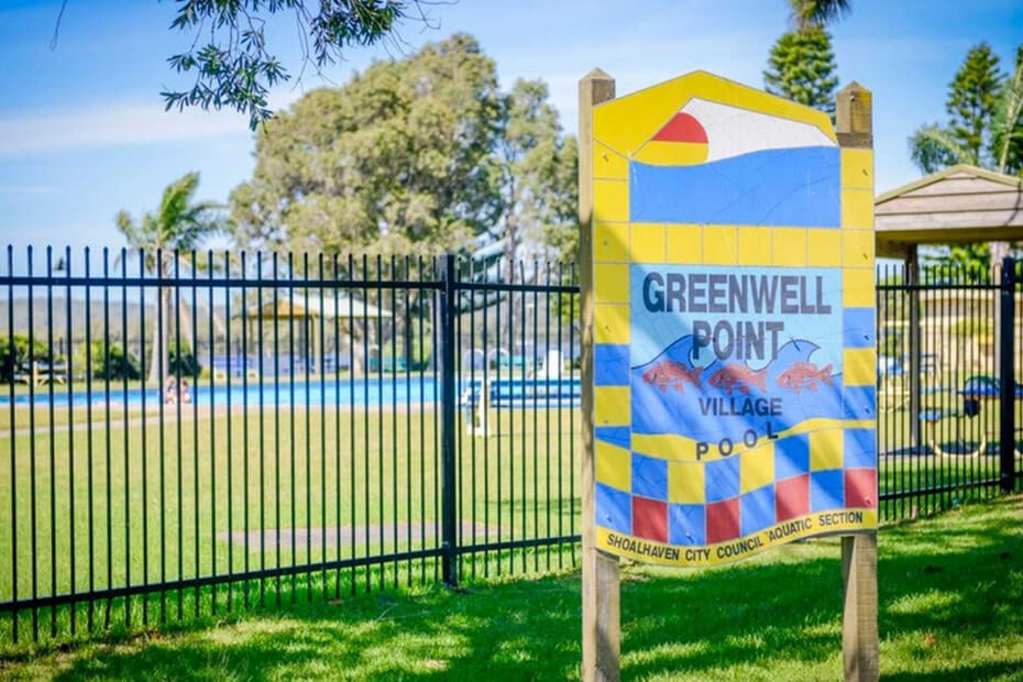 Exterior photo of Greenwell Point Village Pool and signage