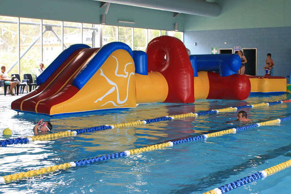 Inflatable obstacle course on the water at Sussex Inlet Aquatic Centre